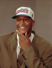 John Wallace's 1996 NBA draft photo. The Greece Athena product was selected 18th overall by the New York Knicks, five spots five spots after Kobe Bryant, a franchise he still works for in community engagement.