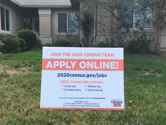 Census recruitment sign posted in a home's yard in Redding in February. Census forms will be mailed to residents on March 12.