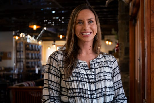 Mikki Trowbridge, owner and founder of Yoga + Beer, poses for a portrait at Gilgamesh Brewing, a location where her classes are held, in Salem on Feb. 26, 2020.