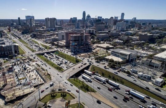 Traffic filters through downtown Austin along Interstate 35 in downtown Austin on Wednesday. The highway is poised to secure full funding for a major overhaul in Austin.