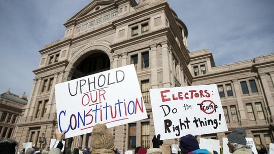 Protesters rally outside the Texas Capitol before the state's Electoral College votes were to be cast in 2016.