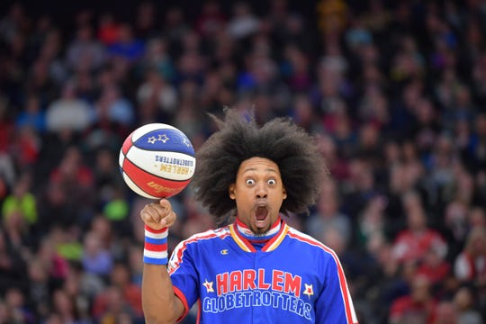 Moose Weekes, a member of the Harlem Globetrotters, shows off ball skills.