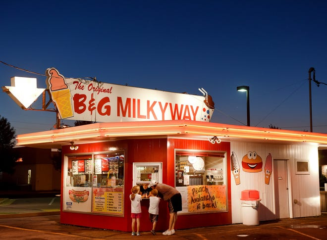 Jera Sands helps customers at the window of the  B&G Milky Way along W. 12th Street on Friday night in Sioux Falls.