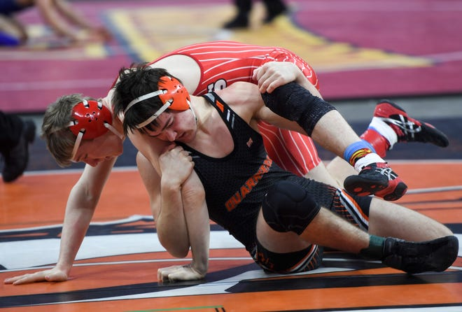Dell Rapid's Gage Carr faces Chamberlain's Noah Hutmacher during the state wrestling tournament on Thursday, Feb. 27, 2020 at the Premier Center.