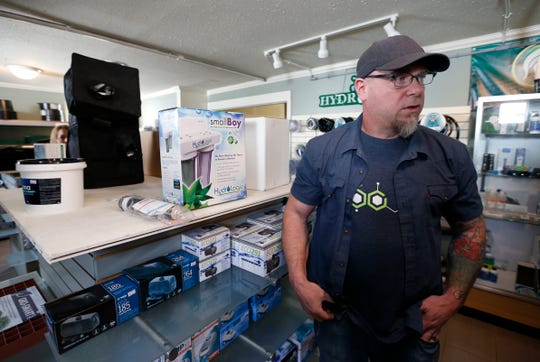 Matt Wolfel talks about the different hydroponics equipment sold at his store, Indoor Garden Supply on South Stewart Avenue in Springfield.