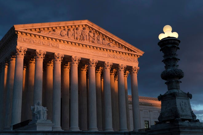 FILE - In this Jan. 24, 2019 file photo, the Supreme Court is seen at sunset in Washington.