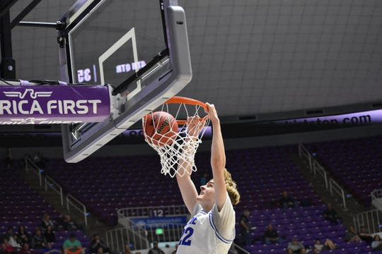 Dixie's Noah Lemke slams home a dunk as the Flyers easily advanced to the semifinals.