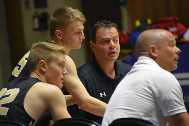 Desert Hills' Wade Turley (middle) is calling it a coaching career after 27 years.