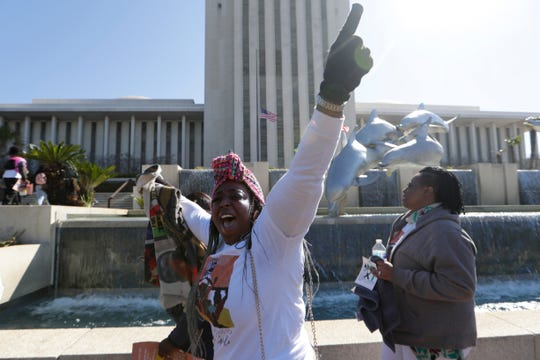 Candii Reid, founder of Girls with Scars Inc., chants with a group of around 150 black women and girls who marched one mile from the Florida People's Advocacy Center to the Capitol for Black Girls Day Thursday, Feb. 27, 2020.