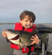 Lake Seminole is on fire! 2 year old Gray Jeter holds up this beauty caught while fishing with dad Nic.