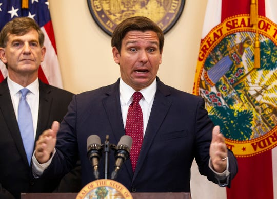 Gov. Ron DeSantis answers questions from the media during a press conference regarding the coronavirus, Thursday, Feb. 27, 2020.