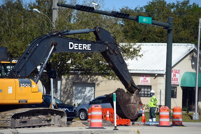 Some counties are trying to accelerate road construction projects, so people keep working and to take advantage of having less people on the road. In this photo, taken Feb. 27, 2020, construction crews work on the intersection of U.S. 1 and 45th Street, Vero Beach, where a new Wawa is being constructed.