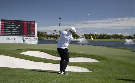 Tom Lewis chips onto the 18th hole where he made a birdie to go 4 under par during the first round of the Honda Classic at PGA National in Palm Beach Gardens, Feb. 27, 2020.