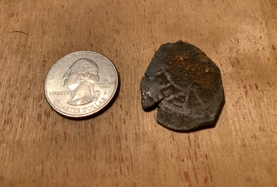 Treasure hunter Jonah Martinez, 43, of Port St. Lucie, found 22 Spanish coins from a 1715 shipwreck at Turtle Trail beach access on Friday, Feb. 21, 2020.