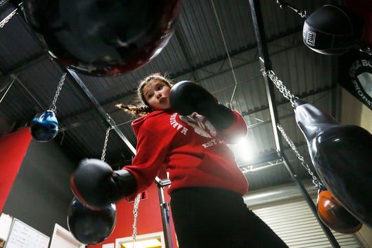 Amateur boxer Keilah Delgado prepares for upcoming fights Wednesday, Feb. 26, at Warriors Edge Boxing in El Paso. Delgado will fight in the El Paso Golden Gloves, March 6-8.