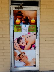 A sign on the door of Montana Massage states it was shut down by the El Paso County Attorney's Office on Wednesday, Feb. 26, 2020.