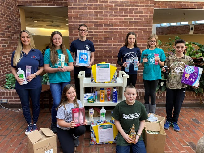 Downe Township Elementary School's Student Council members have been working hard to give back to their community. During the winter season, they collected items to share with the residents of Cumberland Manor Nursing and Rehabilitation Center in Bridgeton. (Front row, from left) Ava Lam and Gavin Langley; and (standing, from left) Brooke Morvay, Student Council Advisor, Makaelyn Wagner, Andrew Cooper, Esther Lore, Delaney Wilford, and Joey Lam, display some of the items they collected.