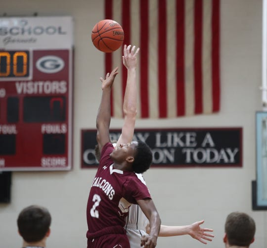 Albertus Magnus' Jaaron Joseph (2) goes up for the jump ball during a 58-51 loss at Rye High School in the Section 1 Class A quarterfinals on Feb. 26, 2020.