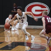 Rye's Rafael Velasquez (3) dribbles over half court during their 58-51 win over Albertus in boys Class A Section 1 quarterfinal basketball game at Rye High School on Wednesday, February 26, 2020.