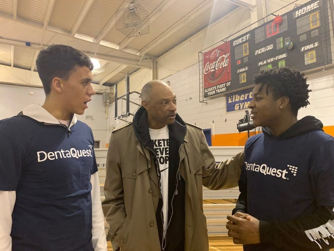 Jim Cleamons talks with basketball team members at an event in the Boys and Girls Club of New Rochelle, Remington Unit.