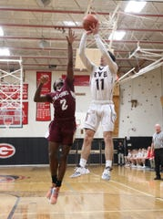 Rye's Quinn Kelly (11) puts up a jumpshot during their 58-51 win over Albertus in boys Class A Section 1 quarterfinal basketball game at Rye High School on Wednesday, February 26, 2020.