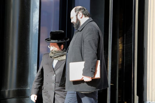 Rabbi Yehuda Oshry, left, and his attorney leave United States District Court in White Plains Feb. 27, 2020.