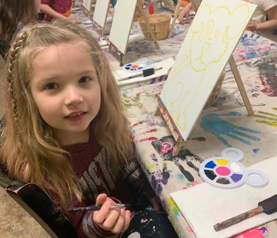 Sydney Hayden does a craft at a party at Chocolatier Matisse in Orangeburg.