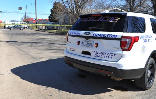 Wichita Falls police block-off neighboring intersection near Kenly Ave. while detectives investigate a deceased person found in a parked car Thursday afternoon.