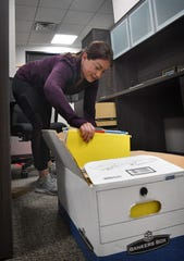 Hillary Robinson, office manager for the Wichita Falls Chamber of Commerce, unpacks files as she moves into the chamber's new offices on the first floor of the Hamilton Building.