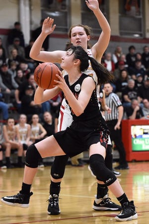 Sophomore Makaela McLaughlin prepares to shoot during Rosecrans' 57-38 loss to Woodsfield Monroe Central on Friday night in a Division IV district semifinal at St. Clairsville.