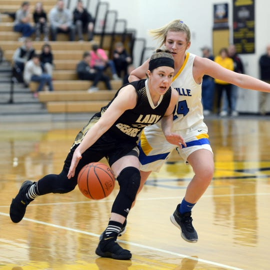 Jessica Hartsock drives to the basket against Alexis Samson during River View's 48-35 loss to Maysville in a Division II district semifinal on Wednesday at Tri-Valley High School.