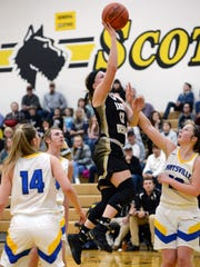 Kelsey Hartsock, of River View, goes up for a shot against Maysville during a Division II district semifinal on Wednesday night at Tri-Valley.