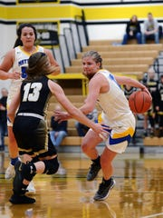 Maysville's Bailee Smith shows off her ball-handling skills during a Division II district semifinal against River View on Wednesday night at Tri-Valley.