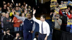 Democratic presidential candidate former South Bend, Ind., Mayor Pete Buttigieg, right, waves to the crowd next to Waterloo, Iowa, Mayor Quentin Hart during a campaign event Saturday, Feb. 1, 2020, in Dubuque, Iowa. (AP Photo/Marcio Jose Sanchez)