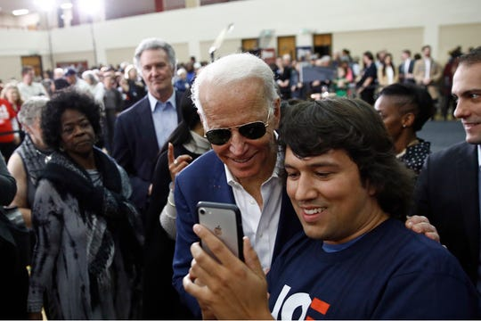 Former Vice President Joe Biden poses for a photo with an attendee after speaking at a campaign event, Monday, Feb. 24, 2020, in Charleston, S.C.