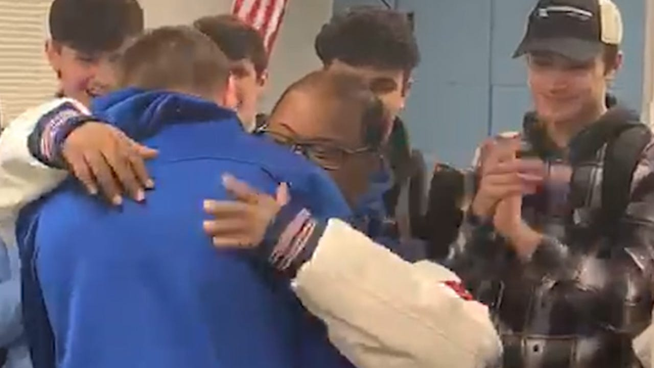 Beloved student surprised by entire football team