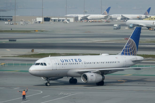 An United Airlines plane is shown on the tarmac from an outdoor terrace and observation deck at San Francisco International Airport in San Francisco on Feb. 20, 2020.