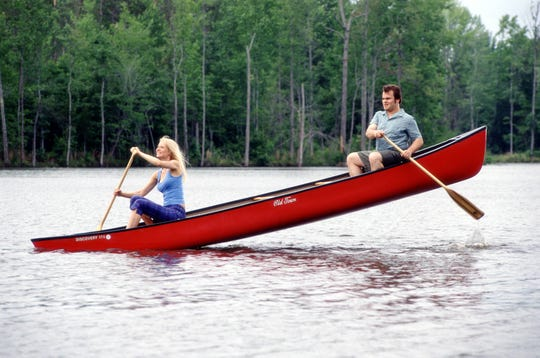 "Gwyneth Paltrow, left, paddles away with  Jack Black in a scene from ""Shallow Hal."""