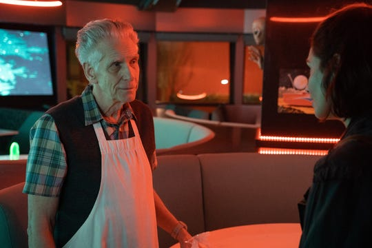 """David Cronenberg (left) stars as a podcaster who helps a young woman (Tuppence Middleton) with a Niagara Falls mystery in """"Disappearance at Clifton Hill."""""""