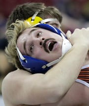 North Fond du Lac/St. Mary's Springs' Marcus Orlandoni wrestles Luxemburg-Casco's Travis Legrave in a 220-pound Division 2 quarterfinal match Friday at the WIAA individual state wrestling tournament at the Kohl Center in Madison.