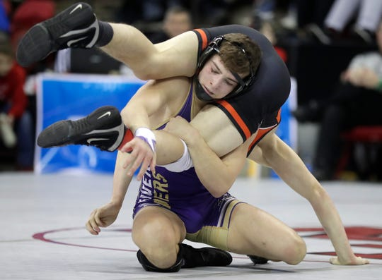Two Rivers' Matty Bianchi battles Richland Center's Max Schmidt in a Division 2 138-pound quarterfinal match during the WIAA individual state wrestling tournament Friday at the Kohl Center in Madison.
