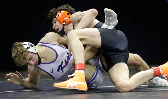 Kiel High School's Andrew Schad Stanley-Boyd/Owen-Withee's Blaine Brenner in a 120-pound Division 2  quarterfinal match during the WIAA individual state wrestling tournament on Friday, Feb. 28, 2020, at the Kohl Center in Madison, Wis.