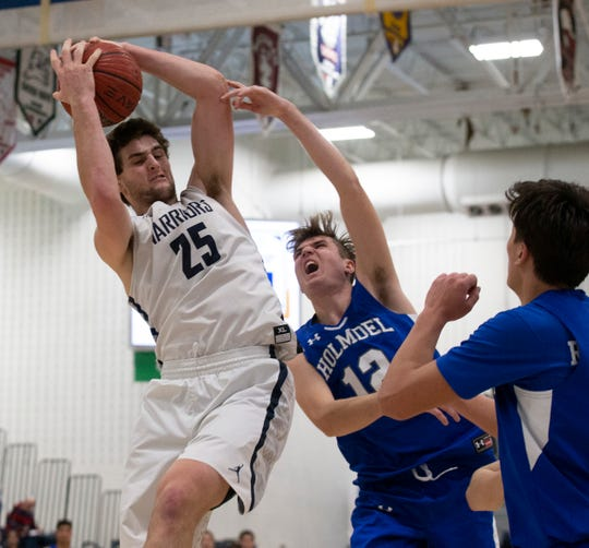 Manasquan Alex Galvan pulls down a rebound in second half action.  Manasquan Boys Basketball vs Holmdel in Shore Conference Tournament Semifinal in Toms River, NJ, on February 27, 2020.