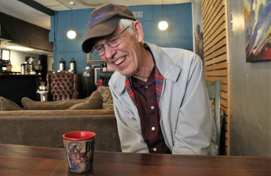 Patrick Brooks laughs while telling a story this week at Monks. Brooks turns 80 on Saturday, making him a leap year baby. He and his wife of 52 years, Kathleen, have lived in Abilene since 2008.