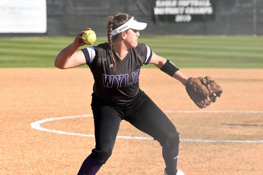 Wylie third baseman Bailey Buck (4) throws to first for an out after fielding a bunt against Lubbock High at the Abilene Ice Breaker on Thursday. The Lady Bulldogs won 8-0 in five innings.
