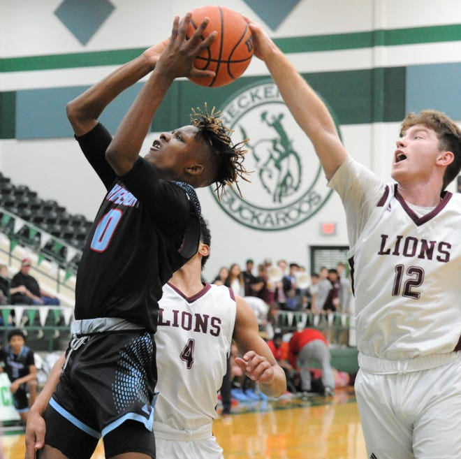 Brownwood senior John Wilheim goes for a block on Wichita Falls Hirschi's Ernest Young in a Region I-4A area playoff Thursday, Feb. 27, 2020, at the Breckenridge ISD Athletic and Fine Arts Center. A shooting foul was called on the play.