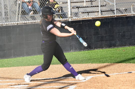 Wylie's Bailey Buck (4) turns on a pitch for a home run against Lubbock High at the Abilene Ice Breaker on Thursday. Buck has five doubles, three home runs and a triple early in the season.
