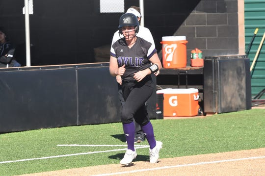 Wylie's Bailey Buck (4) rounds third base after a home run against Lubbock High at the Abilene Ice Breaker on Thursday. Buck and the Lady Bulldogs have won nine-straight games entering Saturday.