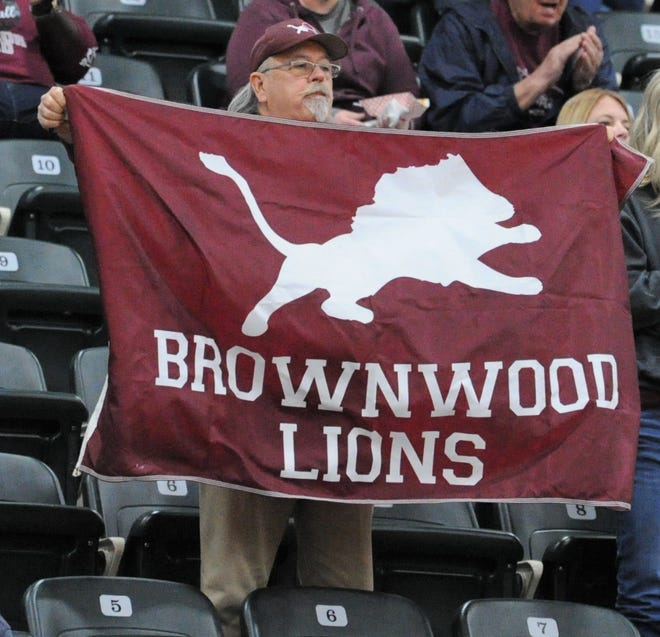 A Brownwood fan waves his flags during pregame introductions in a Region I-4A area playoff Thursday, Feb. 27, 2020, at the Breckenridge ISD Athletic and Fine Arts Center.