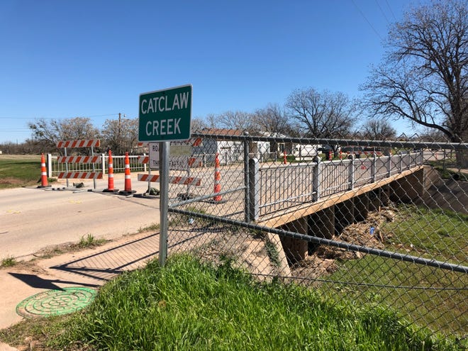 The North 18th Street bridge over Catclaw Creek and between Park Avenue and Kirkwood Street was closed Wednesday because of a hole in the decking and exposed steel.